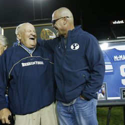 Former Cougar QB Jim McMahon and former coach Lavell Edwards laugh as he is honored at halftime in Provo Friday, Oct. 3, 2014.