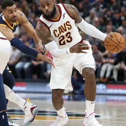 Cleveland Cavaliers forward LeBron James (23) moves around Utah Jazz forward Thabo Sefolosha (22) at Vivint Arena in Salt Lake City on Saturday, Dec. 30, 2017.