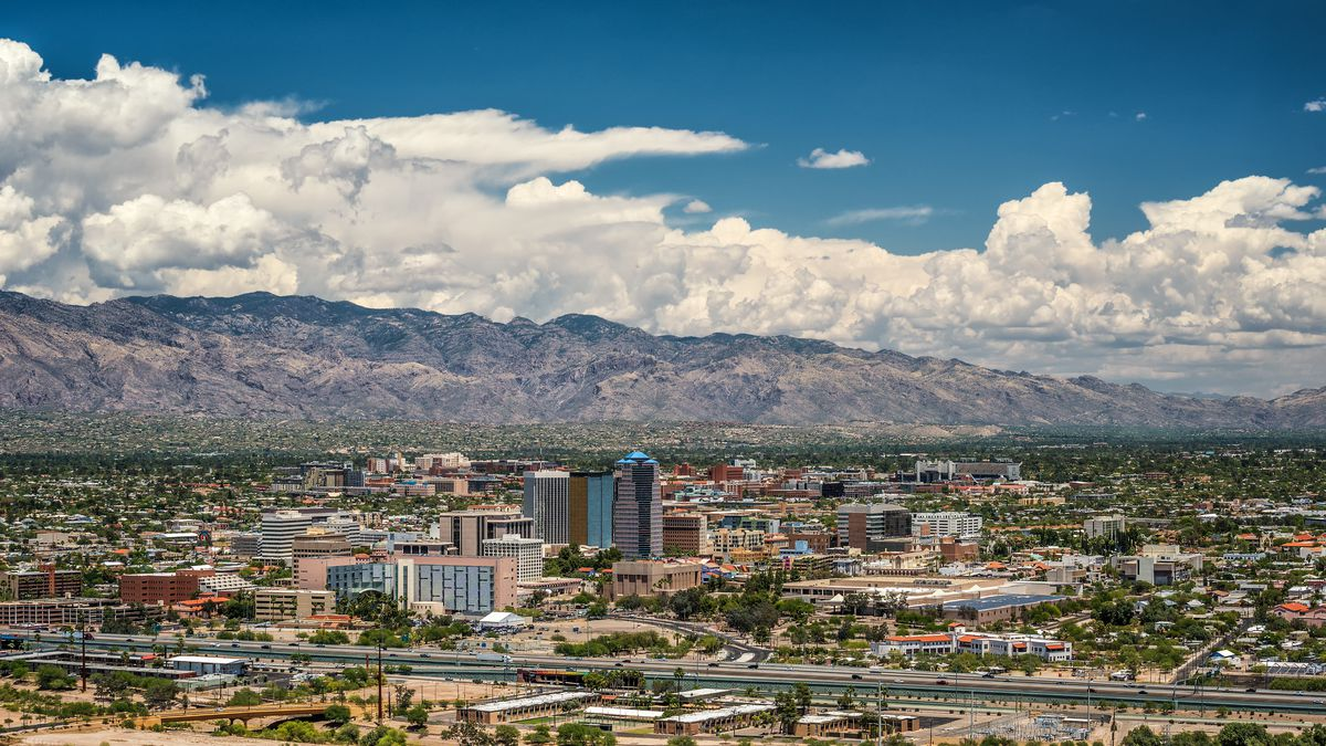 aerial view of Tucson skyline, with mountains in the background.