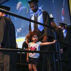 Salt Lake Community College graduate Meckell Gilot waits in line with his daughter to receive his diploma during the 2017 commencement ceremony at the Maverik Center in West Valley City on Friday, May 5, 2017.