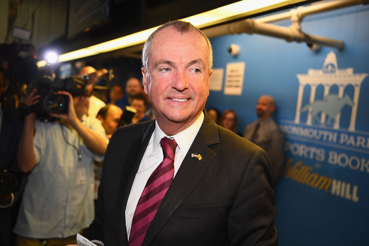 Governor of New Jersey Phil Murphy places the first bet at the William Hill Sports Book at Monmouth Park as it opens and welcomes public to place first legal sports bets on June 14, 2018 in Oceanport, New Jersey.