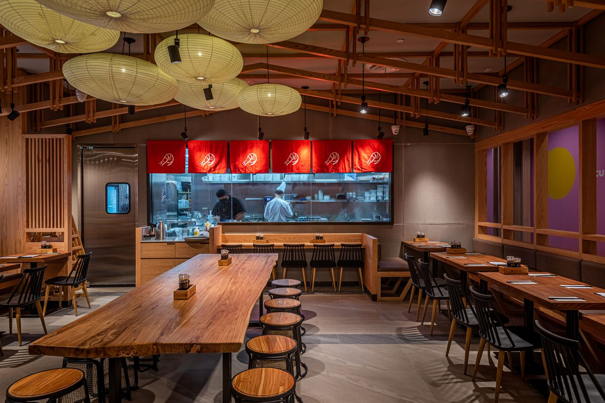 A wood-wrapped restaurant with tall ceilings serving ramen.