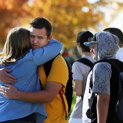 Families reunite at Mountain View High School in Orem on Tuesday, Nov. 15, 2016, after five students were stabbed in an apparent attack by a 16-year-old boy.
