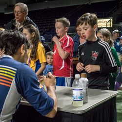 When the game ends, fans are invited onto the field to meet the players and get autographs
