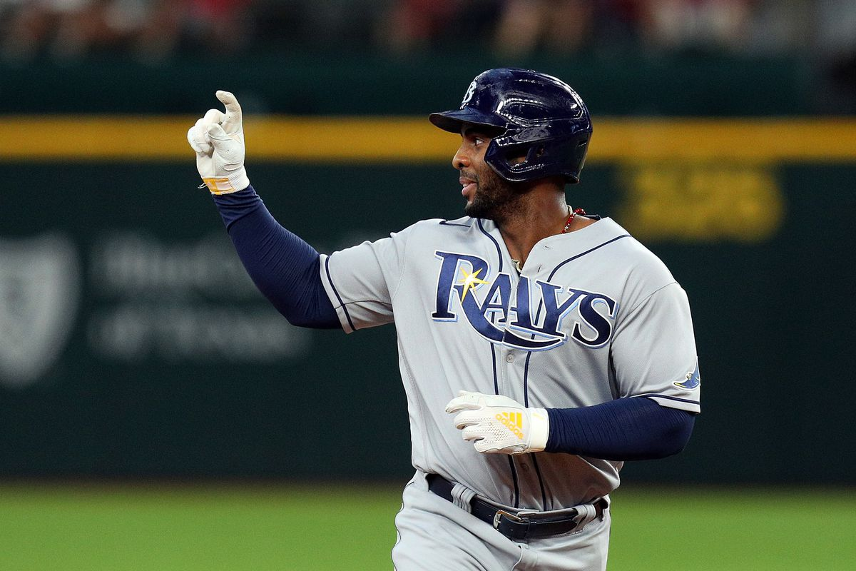 Yandy Diaz #2 of the Tampa Bay Rays gestures as he runs the bases after a two-run home run against the Texas Rangers in the ninth inning at Globe Life Field on June 06, 2021 in Arlington, Texas.