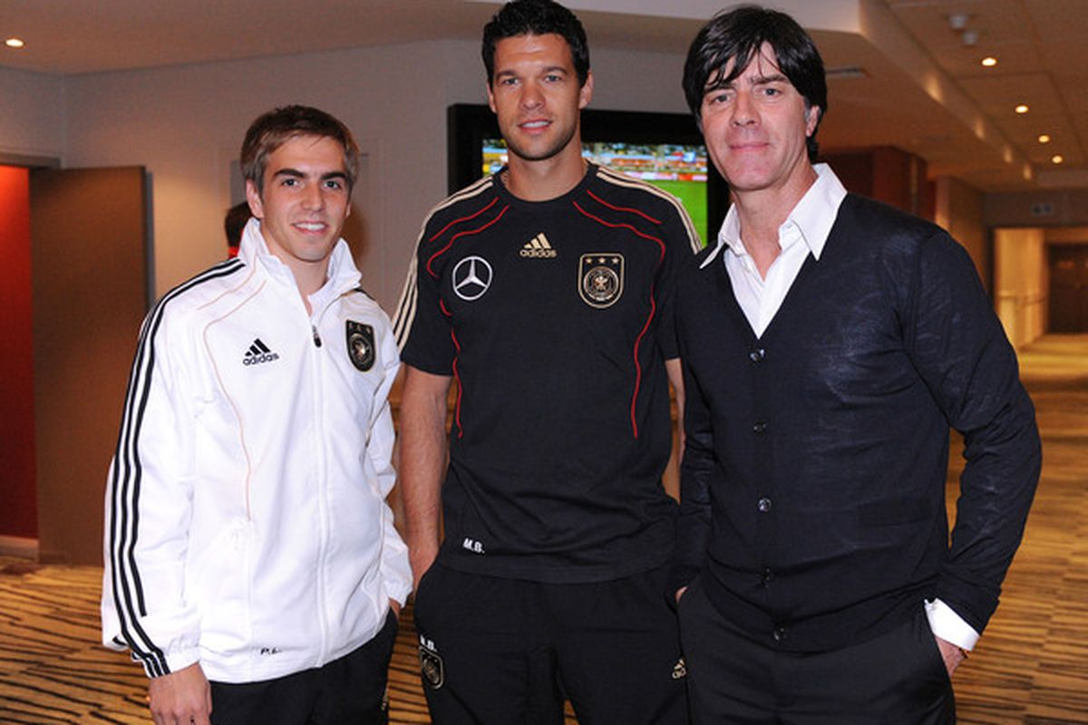 CAPETOWN SOUTH AFRICA - JULY 01: Head coach of Germany Joachim Loew (R) poses with Michael Ballack (C) and Philipp Lahm in the Hotel Southern Sun on July 1 2010 in Capetown South Africa. (Photo by Michael Kienzler-Pool/Getty Images)