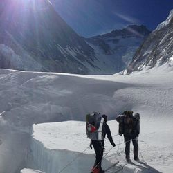 Steve Pearson crosses an aluminum ladder on his journey to the summit of Mount Everest.