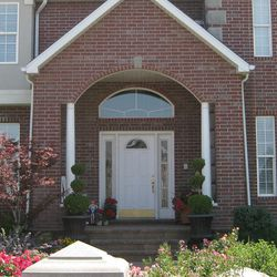 Before: Upgrading the front door can enhance curb appeal and energy efficiency.
