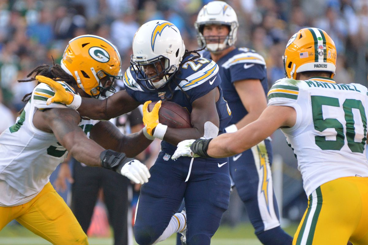 Los Angeles Chargers running back Melvin Gordon runs as Green Bay Packers outside linebacker Za'Darius Smith and inside linebacker Blake Martinez defend during the fourth quarter at Dignity Health Sports Park.