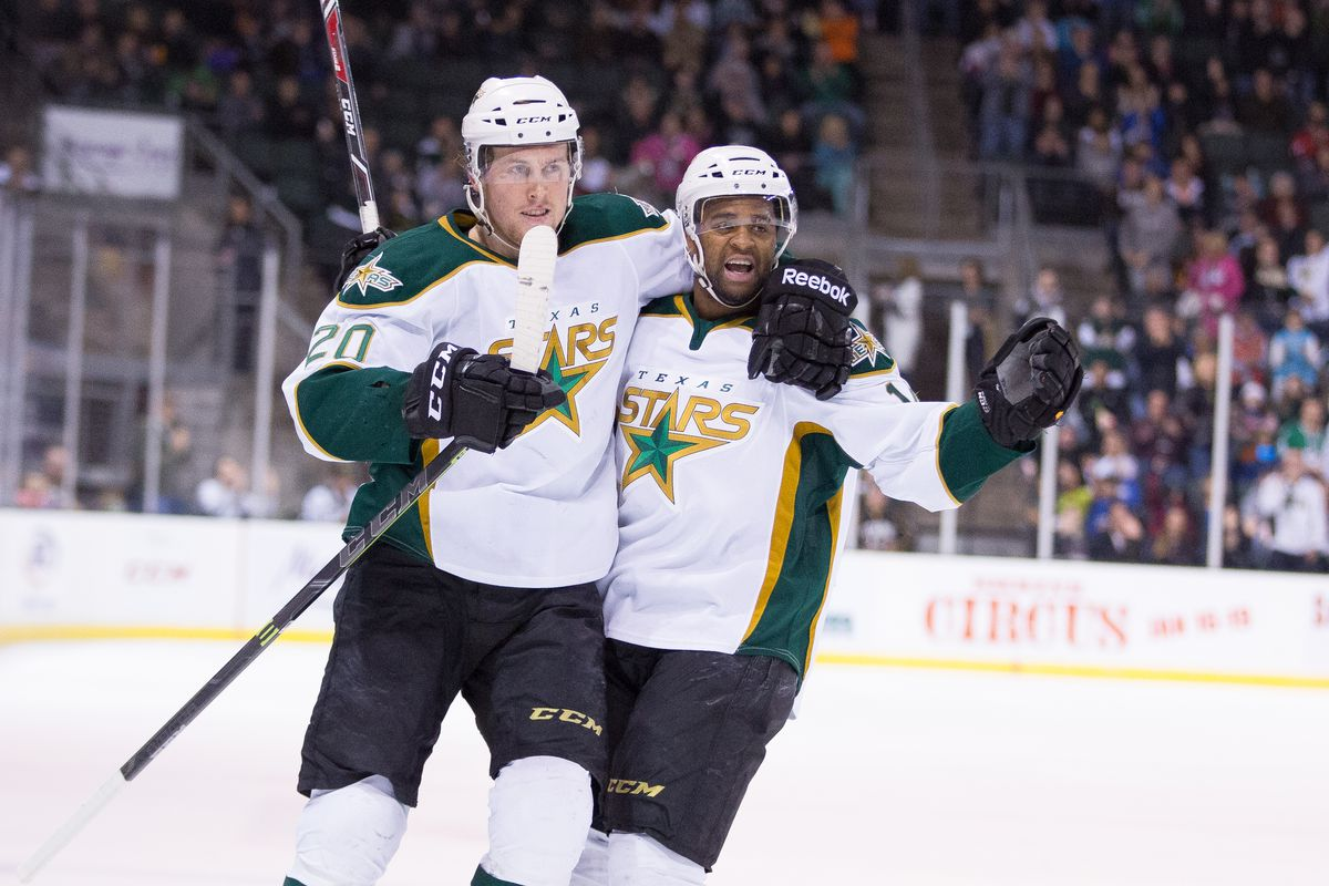 Brett Ritchie and Gemel Smith celebrate one of the five goals their line, including Curtis McKenzie, had on Sunday.