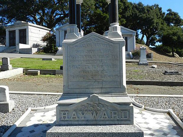 The Lone Tree Cemetery in California. There are multiple grave sites. The tombstone in the foreground reads: Hayward.