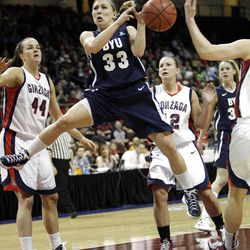 Brigham Young Cougars guard Haley Steed (33) drives on Gonzaga Bulldogs forward Kelly Bowen (44)  in the West Coast Conference finals in Las Vegas  Monday, March 5, 2012.  BYU won the title and will advance to the NCAA tournament.