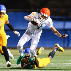Morgan Park's Jayon Moffat (4) is taken down during the game against Simeon.