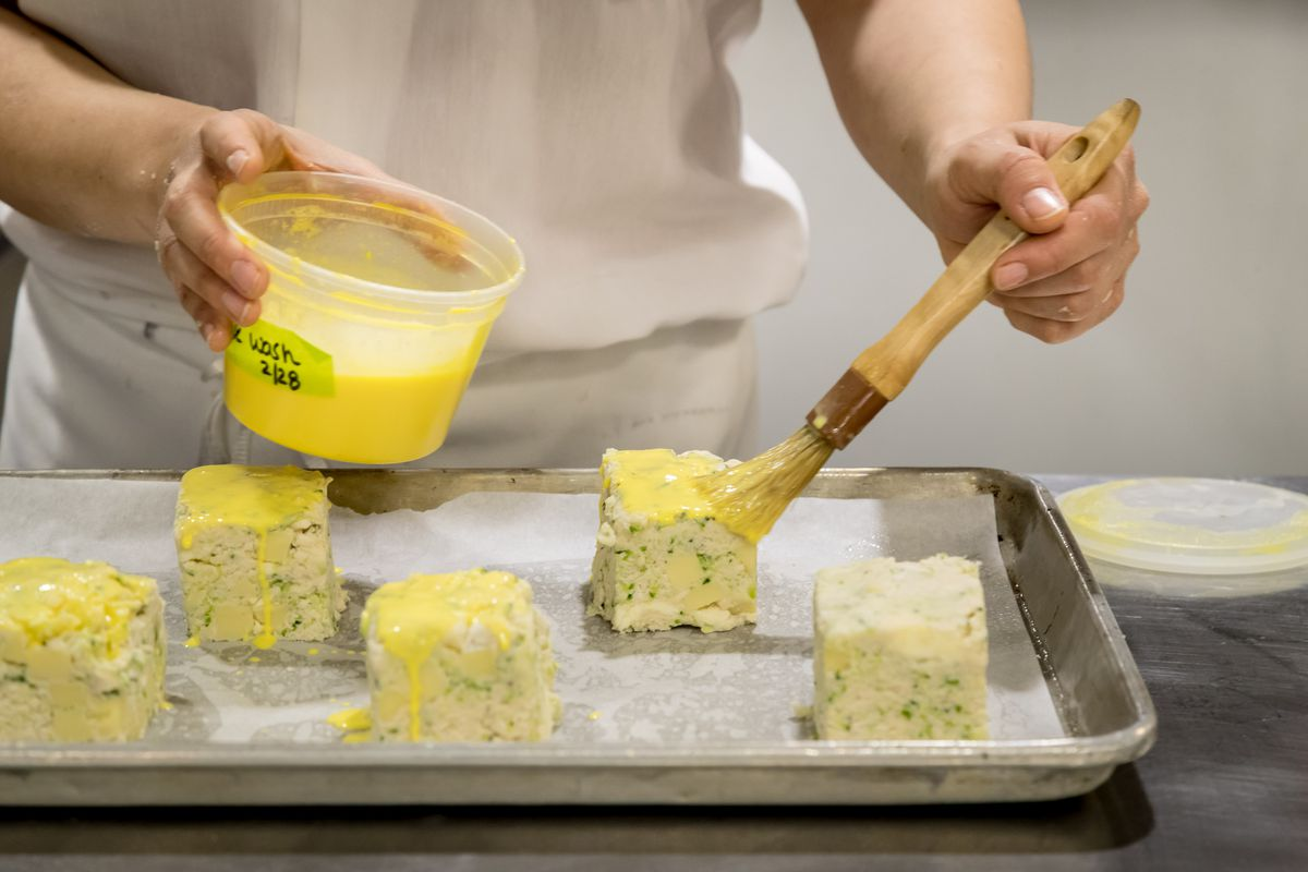 An egg wash goes on the scone