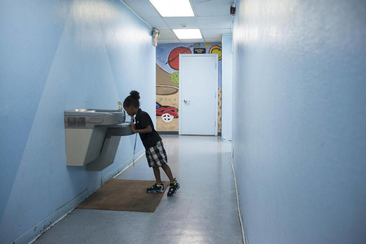 First grader Charles Goudeau gets a drink at Children First Academy in Phoenix on Aug. 29, 2012.  The only metropolitan Phoenix school for homeless students is moving after years of operating as the Thomas J. Pappas Schools. Now known as Children First Ac