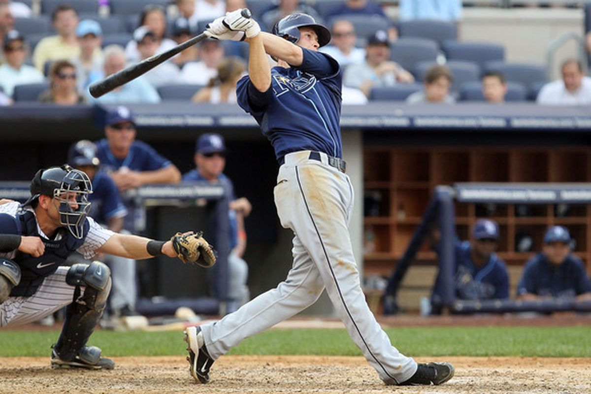 NEW YORK - JULY 17:  Reid Brignac #15 of the Tampa Bay Rays follows through his fifth inning three run home run against the New York Yankees on July 17 2010 at Yankee Stadium in the Bronx borough of New York City.  (Photo by Jim McIsaac/Getty Images)