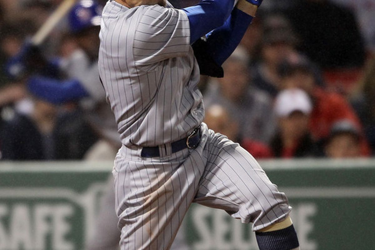 Reed Johnson of the Chicago Cubs hits a 2 RBI double in the eighth inning against the Boston Red Sox on May 21, 2011 at Fenway Park in Boston, Massachusetts. (Photo by Elsa/Getty Images)