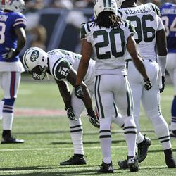 """In this Sept. 9, 2012 photo, New York Jets' Darrelle Revis (24) gets up slowly after being injured on a play during the first half of an NFL football game against the Buffalo Bills, at MetLife Stadium in East Rutherford, N.J. The star cornerback suffered what the team called a """"mild concussion."""" Jets teammate Kyle Wilson (20) and Muhammed Wilkerson (96) are in the foreground."""