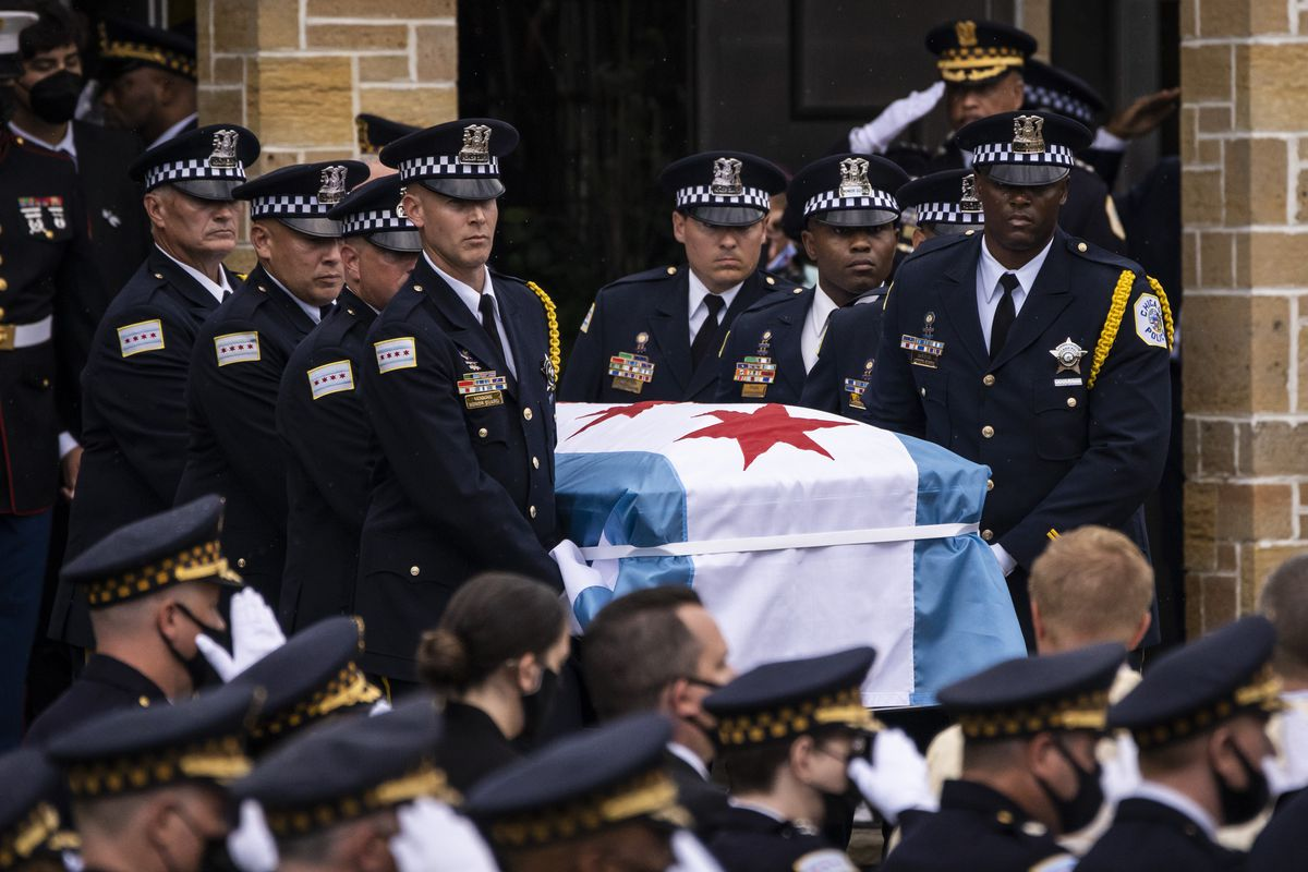 Pallbearers carry the casket for Chicago Police Officer Ella French out of St. Rita of Cascia Shrine Chapel after her funeral Thursday.