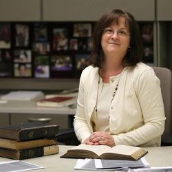 Lisa Tait, research historian, poses for a photo in her office at the LDS Church History Library in Salt Lake City on Thursday, Dec. 3, 2015.