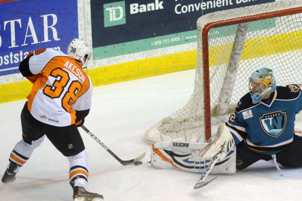Worcester Sharks goaltender Alex Stalock makes one of his 26 saves by extending his pad to deny Adirondack Phantoms forward Jason Akeson of a goal Saturday night at the Glens Falls Civic Center.