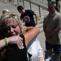 Laurie Holt, mother of Josh Holt, hugs friend Sonia Ibrahim, left, at the end of a rally at the Capitol in Salt Lake City on Saturday, July 30, 2016. Family members and supporters held a rally to call for the release of Josh Holt, who has been jailed in Venezuela.
