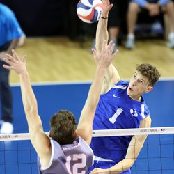BYU's Davide Gardini, spikes the ball with Pepperdine's Jacob Steele trying to defend as BYU and Pepperdine play in the finals of the Mountain Pacific Sports Federation Championship, at the Smith Field House in Provo on Saturday, April 24, 2021. BYU won in straight sets.