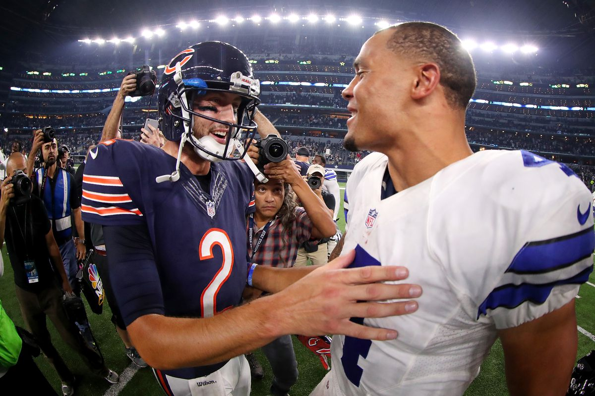 Dak Prescott of the Dallas Cowboys talks with Brian Hoyer of the Chicago Bears after the Cowboys beat the Bears 31-17 at AT&T Stadium on September 25, 2016 in Arlington, Texas.