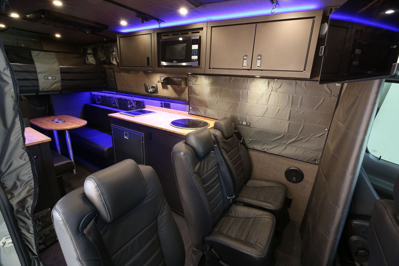 Camper van sleeps four and hides a clever bathroom - Curbed