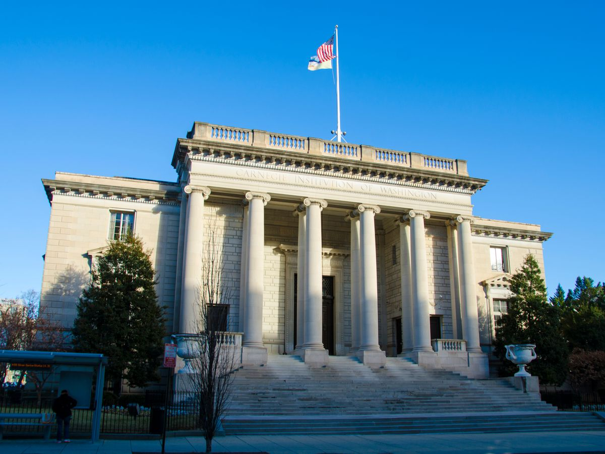 The exterior of the Carnegie Institution for Science. The facade is white with columns.