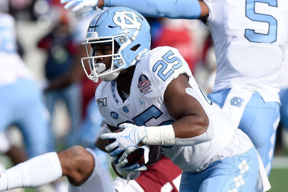 Javonte Williams #25 of the North Carolina Tar Heels rushes the ball against the Temple Owls in the Military Bowl Presented by Northrop Grumman at Navy-Marine Corps Memorial Stadium on December 27, 2019 in Annapolis, Maryland.