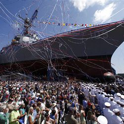 Streamers fly during the christening ceremony of the USS Jason Dunham, an Arleigh-Burke Class destroyer, Saturday, Aug. 1, 2009, at Bath iron Works in Bath, Maine. Gen. Michael W. Hagee gives the principal speech during the christening ceremony of the USS Jason Dunham, an Arleigh-Burke Class destroyer, Saturday, Aug. 1, 2009, at Bath Iron Works in Bath, Maine. The ship is named after her son, the late Marine Cpl. Jason L. Dunham, of Scio, N.Y.  Dunham, 22, of Scio, N.Y., mortally wounded as he saved his comrades that day, will be honored Saturday at the christening of the Navy's newest destroyer, the USS Jason Dunham. The young corporal who threw his Kevlar helmet and his body onto the grenade became the first Marine since the Vietnam War to receive the Medal of Honor, the nation's highest military honor. (AP Photo/Robert F. Bukaty)