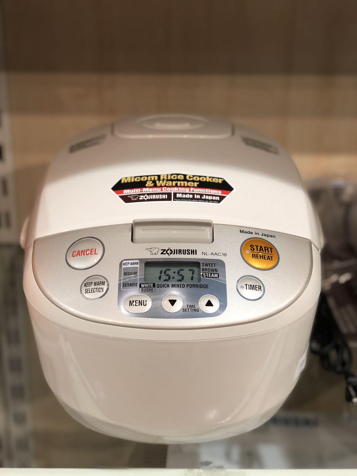 a rice cooker on a shelf