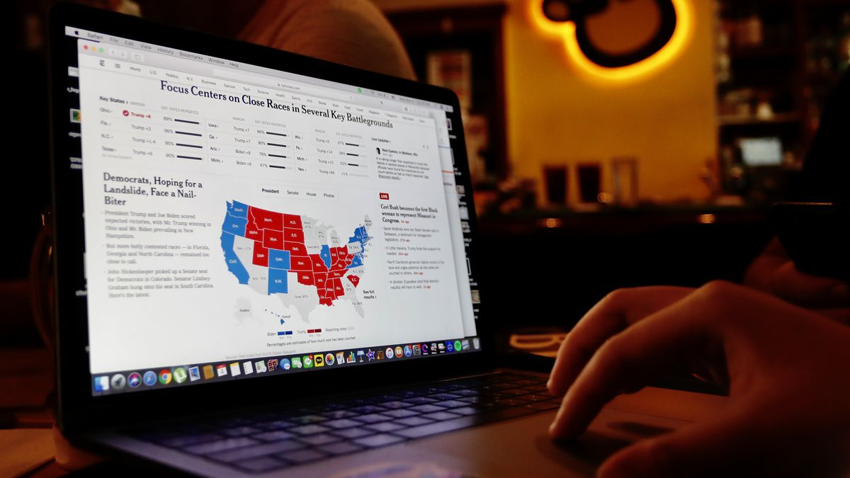 A person looking at election results on their computer.