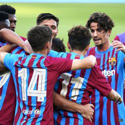 Barcelona players celebrate with Manaj