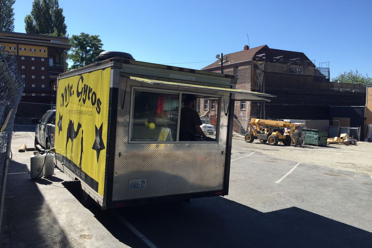 The Mr. Gyros truck overlooking its former brick and mortar home on Greenwood Ave N.