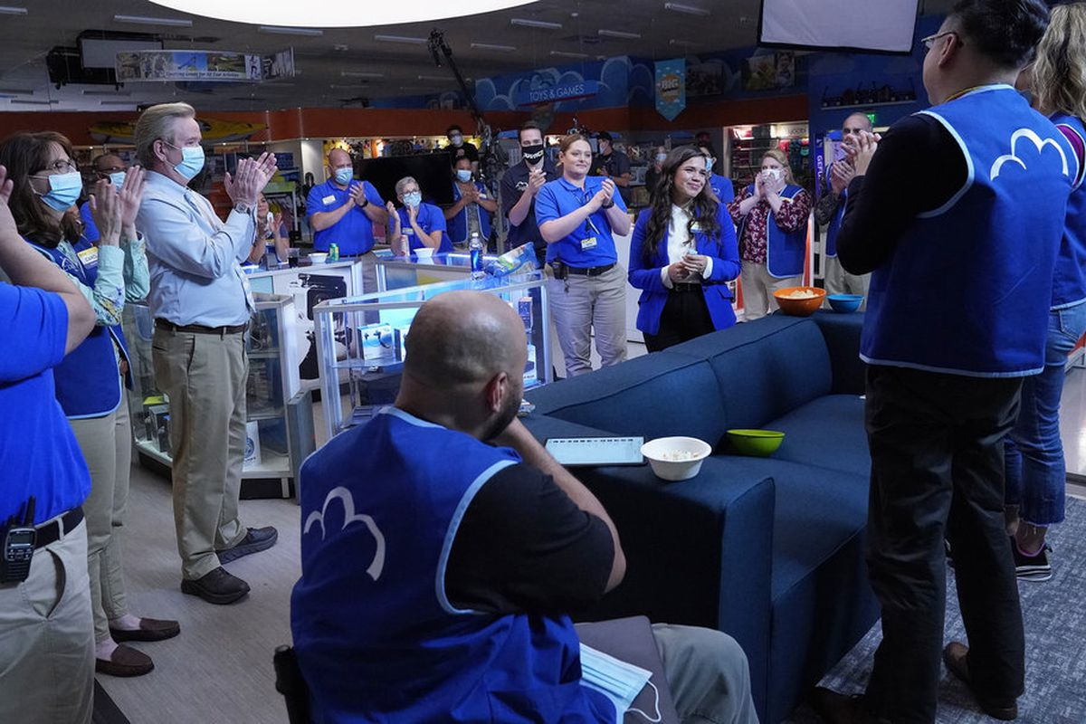 Superstore cast members applaud departing cast member America Ferrera on set for the series' 100th episode.