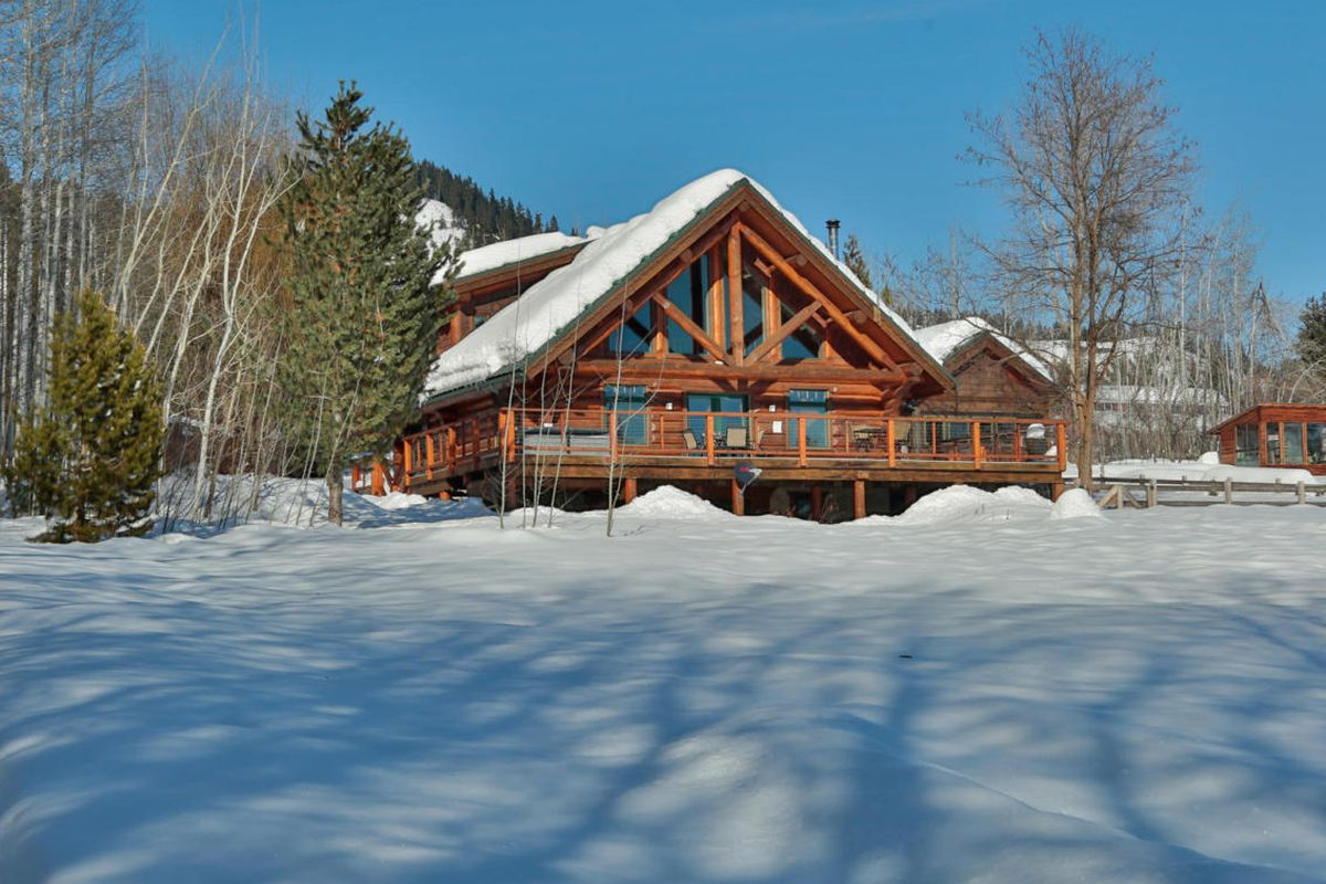 A lodge with a snowy roof
