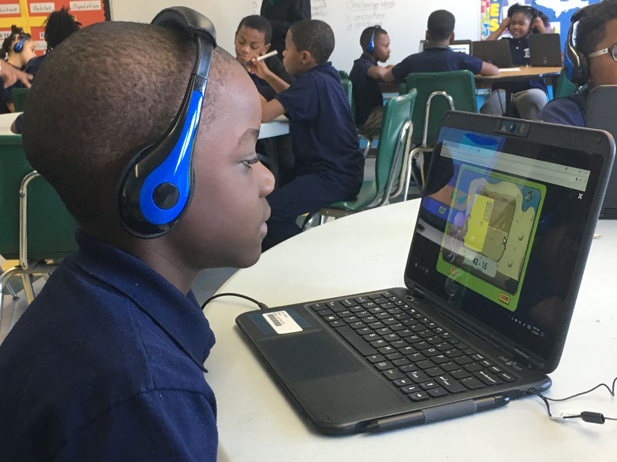 A student at Cooke STEM Academy uses a new personal computer for individual learning.
