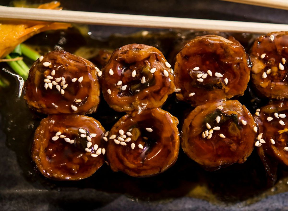 Sauce-covered rolls of sushi