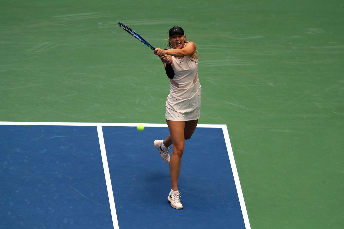 Maria Sharapova serves against Anastasija Sevastova in the fourth round