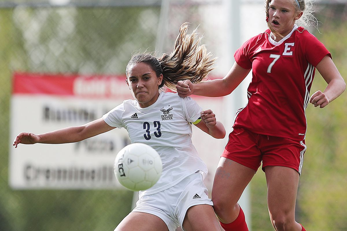 Skyline's Jayda Masina and East's Grace Bergstedt work to control the ball as they play to a 3-3 draw in overtime at East in Salt Lake City on Tuesday, Sept. 10, 2019.