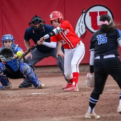 Utah infielder Breonna Castaneda (12) reaches out and slaps a foul as the University of Utah hosts Brigham Young University at Duke Stadium in Salt Lake City on Wednesday, April 18, 2018.