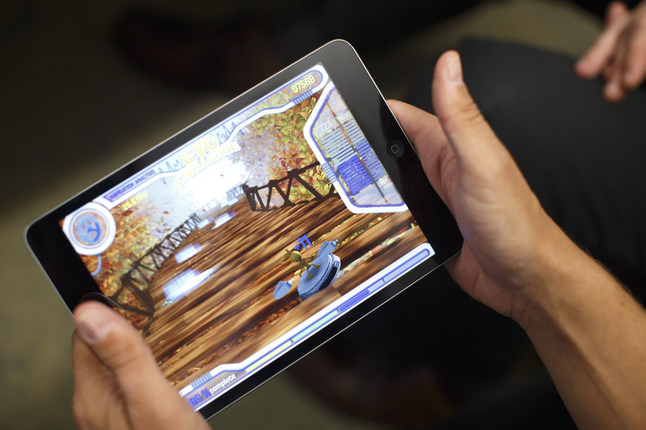 Akili CEO plays the company's video game on an iPad.