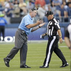 FILE - This Aug. 11, 2012 file photo, shows Tennessee Titans head coach Mike Munchak, left, arguing with a replacement official in the first half of an NFL football preseason game against the Seattle Seahawks, in Seattle. The NFL will open the regular season with replacement officials. League executive Ray Anderson has told the 32 teams that with negotiations remaining at a standstill between the NFL and the officials' union. The replacements will be on the field beginning next Wednesday night when the Cowboys visit the Giants to open the season.
