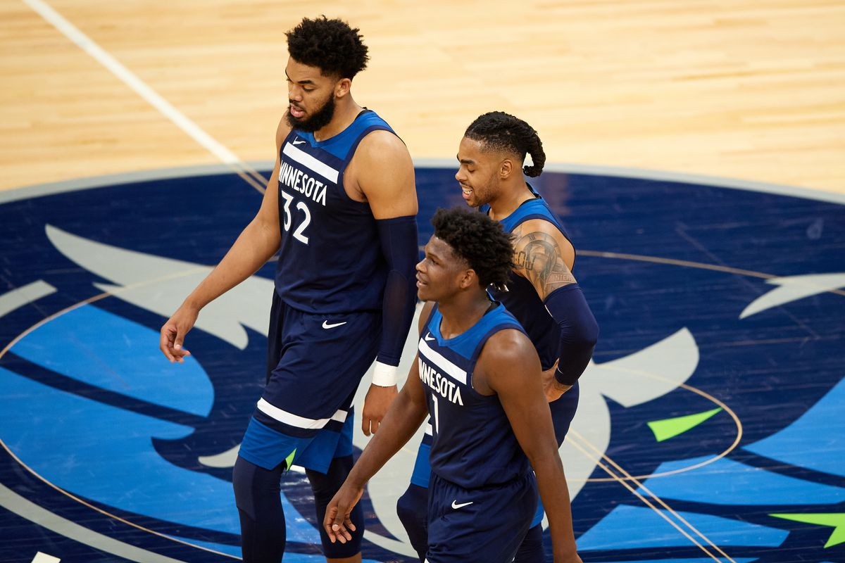 Karl-Anthony Towns, Anthony Edwards and D'Angelo Russell of the Minnesota Timberwolves walk back to the bench for a timeout in the fourth quarter of the game against the Utah Jazz at Target Center on April 26, 2021 in Minneapolis, Minnesota. The Timberwolves defeated the Jazz 105-104.