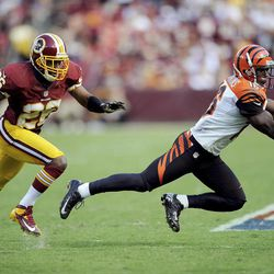 Cincinnati Bengals wide receiver Andrew Hawkins catches a pass  while being defended by Josh Wilson of the Washington Redskins during the second half of an NFL football game in Landover, Md., Sunday, Sept. 23, 2012.