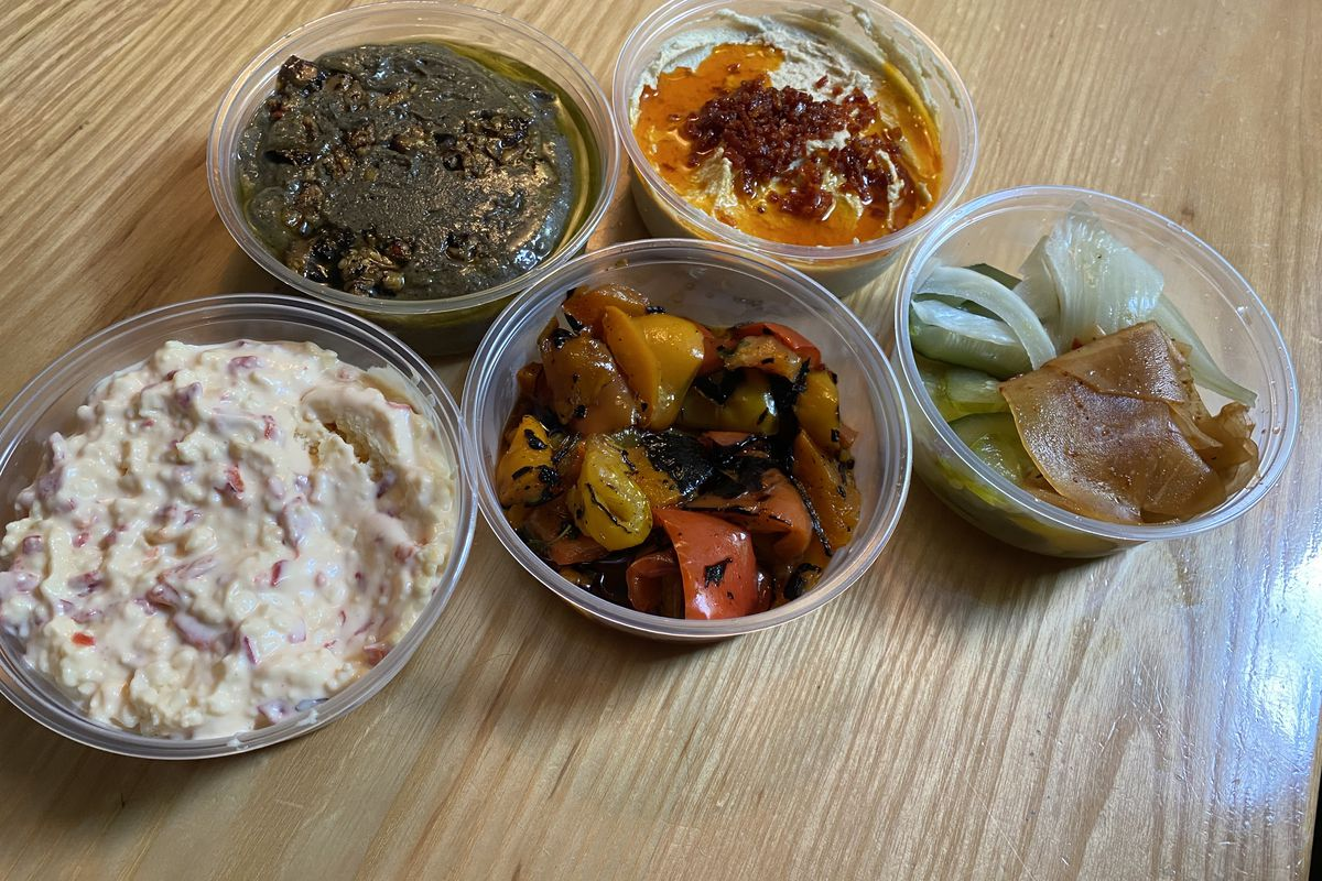 Portable containers of dips and lavash at Maxwell Park.
