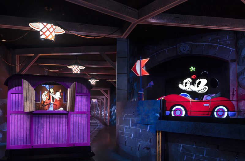 Engineer Goofy says hello to Mickey Mouse and Minnie Mouse in Mickey & Minnie's Runaway Railway