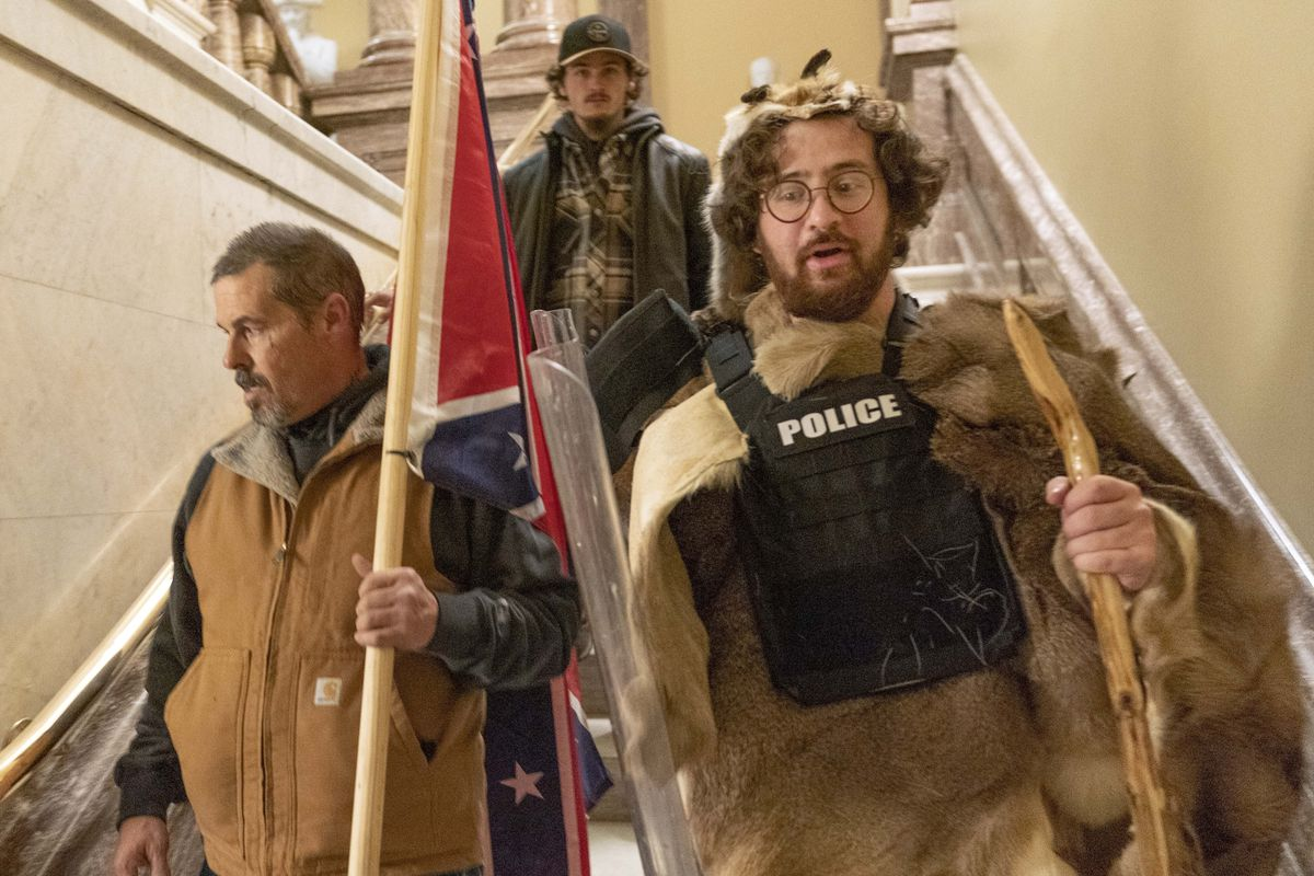 In this Jan. 6, 2021 file photo, insurrectionists loyal to President Donald Trump, including Aaron Mostofsky, right, and Kevin Seefried, left, walk down the stairs outside the Senate Chamber in the U.S. Capitol, in Washington.